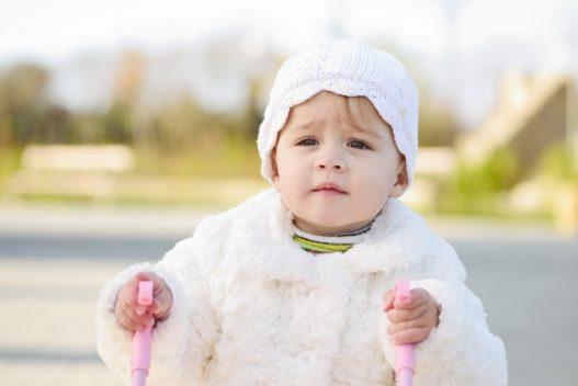 Baby med gåvogn